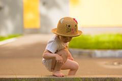 Portrait of a Cute Toddler girl in a funny hat Royalty Free Stock Images