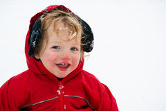 Portrait of cute toddler out in snow Stock Image
