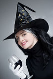 Portrait of a cute witch with hat Royalty Free Stock Images