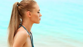 Portrait of cute woman on the beach stock footage