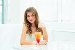 Portrait of a cute woman in a city cafe Royalty Free Stock Photos