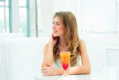 Portrait of a cute woman in a city cafe Royalty Free Stock Image
