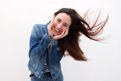 Cute woman in denim jacket with long hair blowing Stock Photos