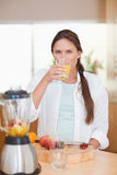 Portrait of a cute woman drinking fresh fruits juice Royalty Free Stock Photos