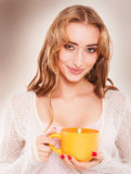 Portrait of cute woman drinking tea or coffee. Royalty Free Stock Photo