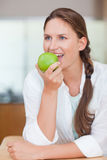 Portrait of a cute woman eating an apple Stock Images