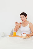 Portrait of a cute woman eating cereal Stock Photo