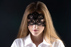 Portrait of cute woman in lace mask royalty free stock images
