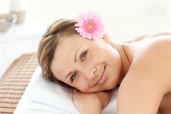 Portrait of a cute woman on a massage table Royalty Free Stock Images