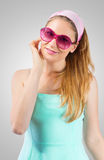 Portrait of cute woman on ose-coloured sunglasses Stock Photos