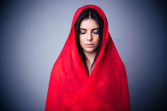 Portrait of a cute woman in red cloth with closed eyes Stock Photo