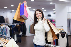 Portrait of cute woman with shopping bags. At fashionable store Stock Photo