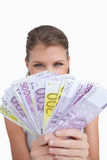 Portrait of a cute woman showing bank notes Stock Photography