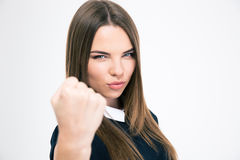 Portrait of a cute woman showing fist. Isolated on a white background Stock Photography