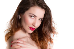 Portrait of cute woman touching shoulder closeup isolated Royalty Free Stock Images