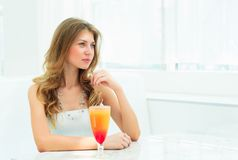 Portrait of a cute woman in a city cafe Stock Photography