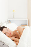 Portrait of a cute woman waking up Stock Photography