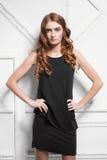 Portrait of cute woman. Wearing black dress posing in the studio Stock Photo