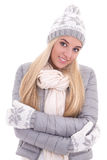 Portrait of cute woman in winter clothes posing isolated on whit Royalty Free Stock Image