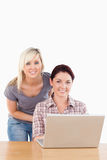 Portrait of cute women with a laptop Royalty Free Stock Photo