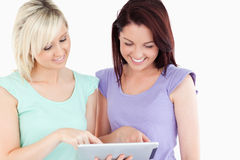Portrait of cute women with a tablet Stock Image