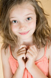 Portrait of a cute 8 year old girl. Studio photography on brown (orange) background Royalty Free Stock Images