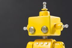 Portrait of a Cute, yellow, handmade robot royalty free stock photography
