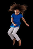 Portrait of Young African American girl jumping Royalty Free Stock Photos
