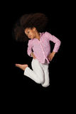 Portrait of Young African American girl jumping Stock Photos