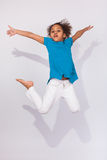 Portrait of Young African American girl jumping Royalty Free Stock Photography