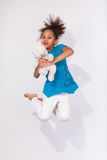 Portrait of Young African American girl jumping Stock Image