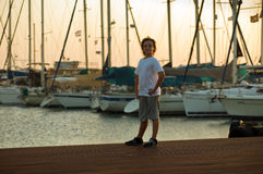 Portrait of a cute young boy . Portrait of a boy on the docks at the yacht club in Tel Aviv Stock Images