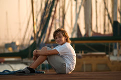 Portrait of a cute young boy . Portrait of a boy on the docks at the yacht club in Tel Aviv stock photography