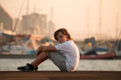 Portrait of a cute young boy . Portrait of a boy on the docks at the yacht club in Tel Aviv Royalty Free Stock Photo