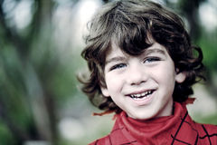 Portrait of a cute young boy outside Stock Photos