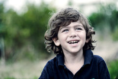 Portrait of a cute young boy outside Stock Photography