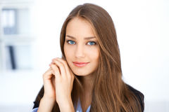 Portrait of cute young business woman in office Royalty Free Stock Images
