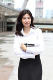 Portrait of cute young business woman outdoor with her note book Stock Photography