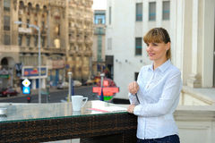 Portrait of cute young business woman outdoorwith coffee. Royalty Free Stock Photo