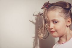 Portrait of a cute little girl. Portrait of a cute young Caucasian little girl with tied hair royalty free stock photography