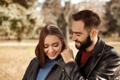 Portrait of cute young couple in park. On sunny day stock image