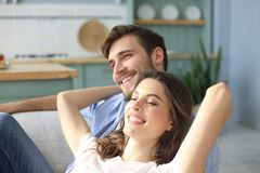 Portrait of cute young couple sitting in sofa.  royalty free stock photos