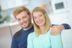 Portrait cute young couple sitting in sofa Royalty Free Stock Images