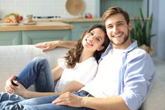Portrait of cute young couple sitting in sofa.  stock images