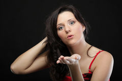 Portrait of a cute young female blowing a kiss towards Royalty Free Stock Photo