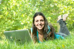 Portrait of a cute young female using a laptop Royalty Free Stock Photo