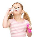 Portrait of a cute young girl blowing soap bubbles Stock Photography