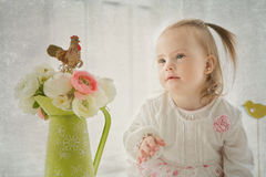 Portrait of a cute young girl with Down's syndrome. Portrait of a cute young little girl with Down's syndrome Royalty Free Stock Image