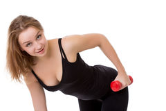 Portrait of cute young girl with dumbbells Stock Photos