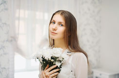 Portrait of a cute young girl with flowers Royalty Free Stock Photography